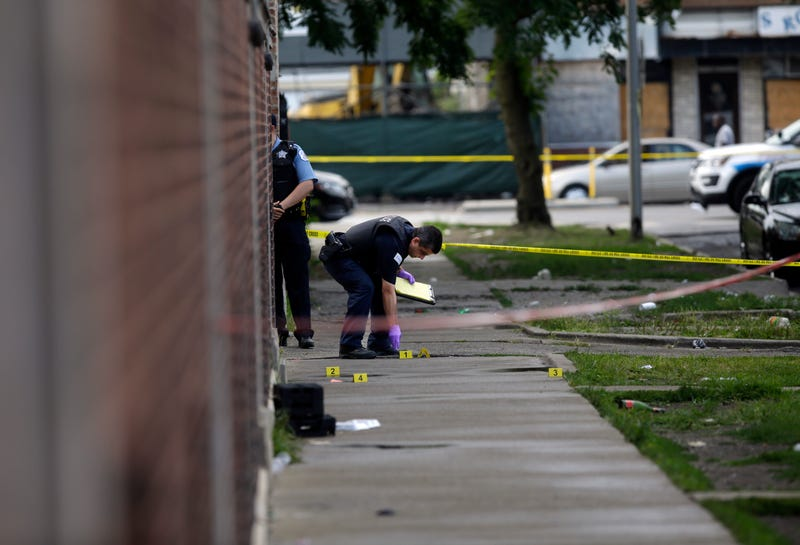 Chicago Police officers and detectives investigate a shooting where multiple people were shot on Sunday, August 5, 2018 in Chicago, Illinois.