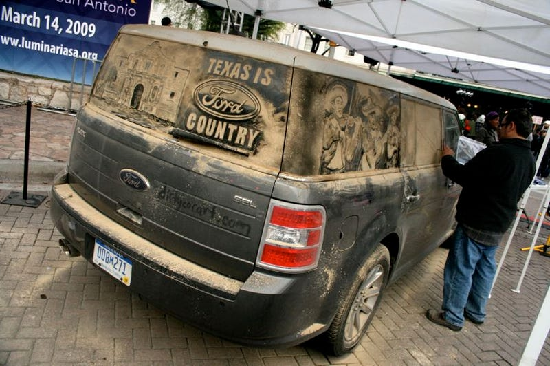 Illustration for article titled Sand Artist Scott Wade Makes Art Out Of Ford Flex
