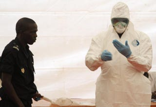 A Senegalese hygienist demonstrates how to protect oneself against the Ebola virus on April 8, 2014, at Dakar airport, during a visit of the Senegalese health minister to check the safety measures put in place to fight against the virus' spread in western Africa.SEYLLOU/AFP/Getty Images