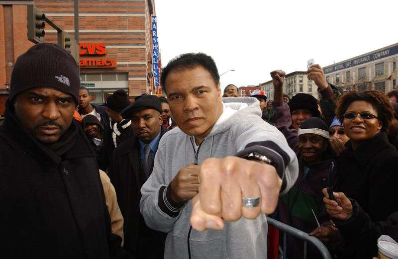Boxing legend Muhammad Ali greets a crowd in Harlem on Feb. 5, 2003.Ezra Shaw/Getty Images
