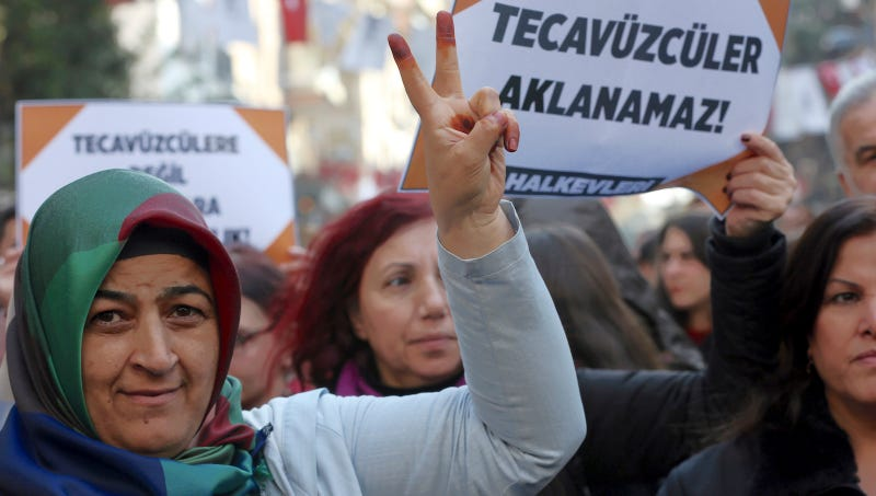 "Protesters in Ankara, the sign reads: ""The rape cannot be pardoned!""/Image via AP."