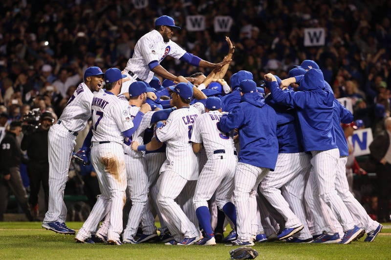 The Chicago Cubs celebrate defeating the St. Louis Cardinals 6-4 in Game 4 of the National League Division Series at Wrigley Field on Oct. 13, 2015, in Chicago. Jonathan Daniel/Getty Images