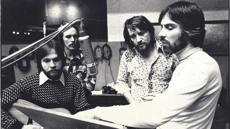 John Dillon, Steve Cash, Waylon Jennings, Glyn Johns. (Photo: Ethan Russell)