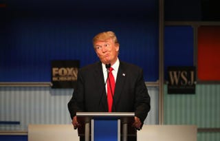 GOP presidential candidate Donald Trump makes a facial expression during the Republican presidential debate in Milwaukee Nov. 10, 2015. Scott Olson/Getty Images
