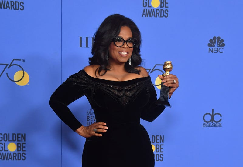Oprah adds a little more gold and recognition to her collections at the 75th Golden Globes. (Photo: Frederic J. Brown/AFP/Getty Images)