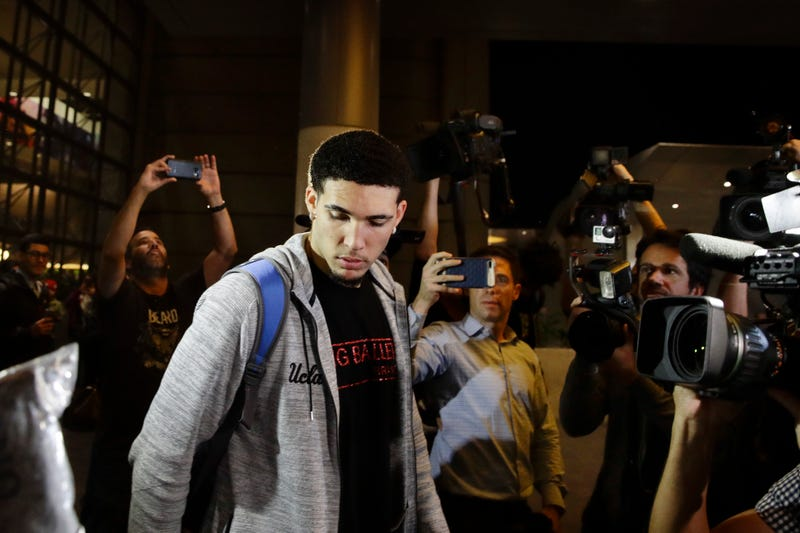 UCLA basketball player LiAngelo Ball is surrounded by the media as he leaves Los Angeles International Airport on Nov. 14, 2017, after his return from China. (Jae C. Hong/AP Images)