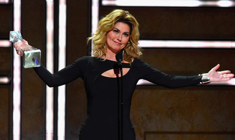 "Shania becoming ""the first and only female to receive CMT's Artist of a Lifetime Award."" Image via Getty."