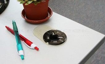 Illustration for article titled Flush-Mount USB Hub Cuts Down on Desk Clutter