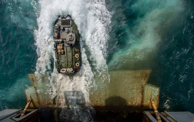 Illustration for article titled Cool photo of an amphibious assault vehicle launched from its mothership