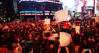 Protesters converge on Times Square in New York City after hearing the news that an NYPD officer would not be charged in the choke hold death of Eric Garner.Twitter
