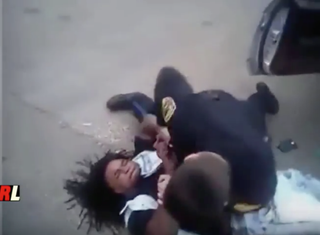 Patrick Newbern Jr. is seen in body-camera video struggling with Blytheville, Ark., police as they bring him to the ground before using a Taser on him and spraying him with a chemical agent.YouTube screenshot