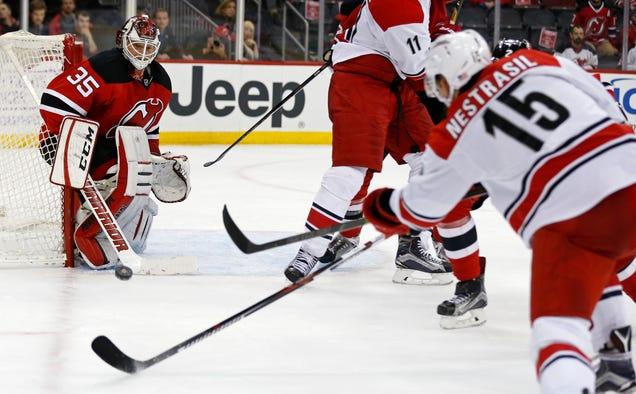 Devils Beat Hurricanes In Hockey Game