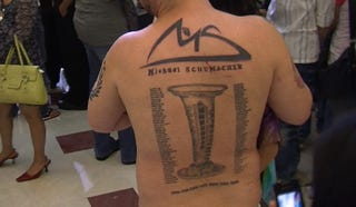 Illustration for article titled Man tattoos Michael Schumacher's entire history on his back