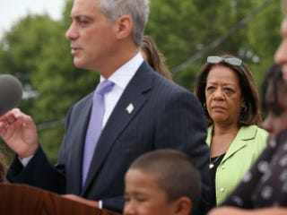 Chicago Public Schools CEO Barbara Byrd-Bennett, center rear, listens as Chicago Mayor Rahm Emanuel announces additions to the city's all-day kindergarten program during a visit to the city's Tonti Elementary School on Aug. 5, 2013. Scott Olson/Getty Images
