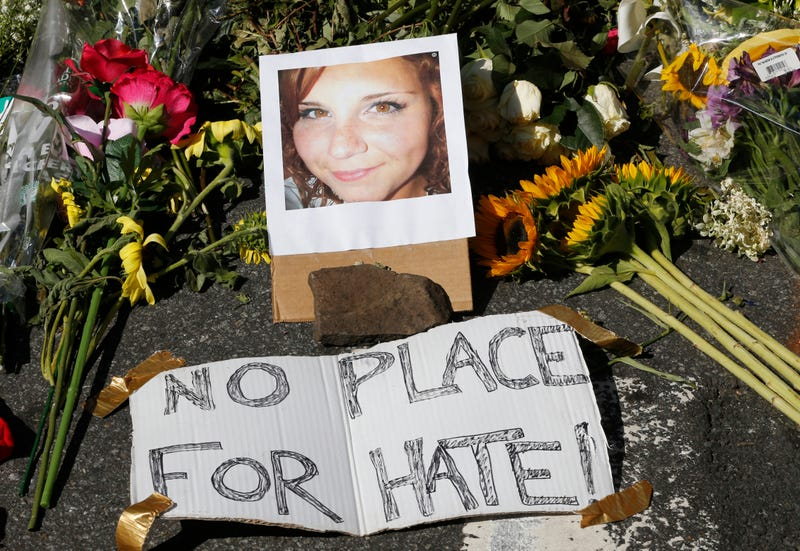 A makeshift memorial of flowers and a photo of the victim, Heather Heyer, sits in Charlottesville, Va., on, Aug. 13, 2017. (Steve Helber/(AP Images)