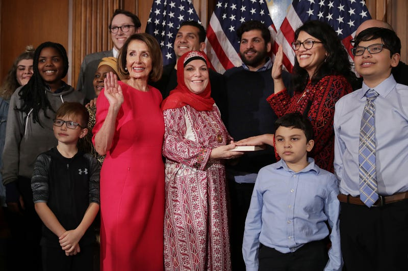 Speaker of the House Nancy Pelosi (D-CA) poses for photographs with Rep. Rashida Tlaib (D-MI) and her family in the Rayburn Room at the U.S. Capitol January 3, 2019, in Washington, DC.