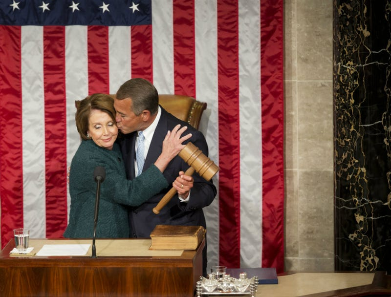 Illustration for article titled Someone Please Help Nancy Pelosi Escape This John Boehner Kiss