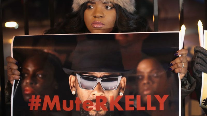 A protestor calling to #MuteRKelly