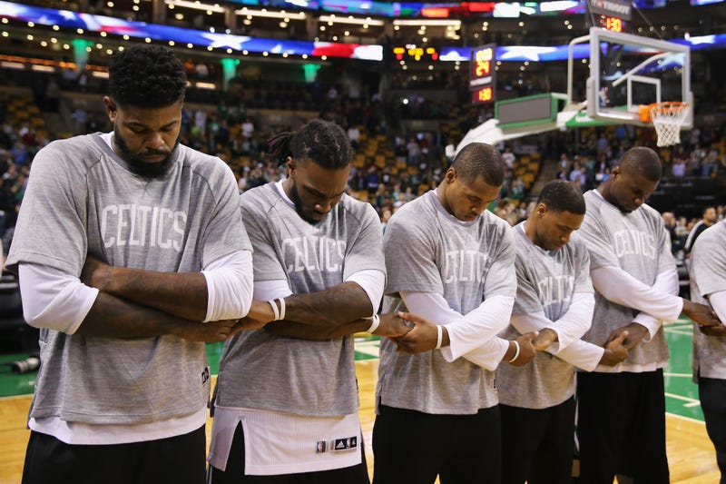 Members of the Boston Celtics link arms during the singing of the national anthem before the preseason game against the Brooklyn Nets at TD Garden on Oct. 17, 2016, in Boston. (Maddie Meyer/Getty Images)