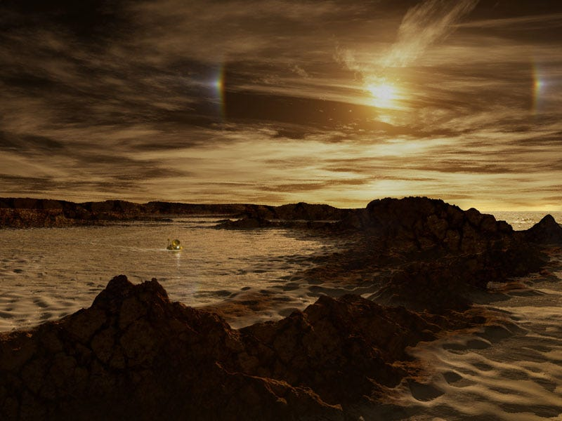 "Illustration for article titled Cassini Find: ""Salt Flats"" Surround Titan's Northern Lakes"