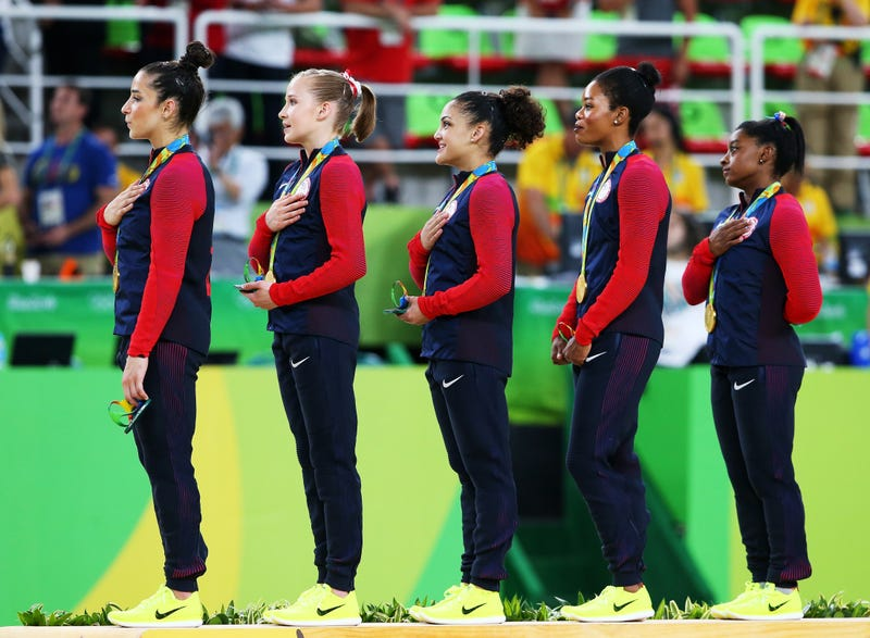Right to left: Gold medalists Simone Biles, Gabrielle Douglas, Lauren Hernandez, Madison Kocian and Alexandra Raisman of the United States stand on the podium for the national anthem at the medal ceremony for the Artistic Gymnastics Women's Team Final on Day 4 of the Rio 2016 Olympic Games at the Rio Olympic Arena on Aug. 9, 2016, in Rio de Janeiro.  Alex Livesey/Getty Images