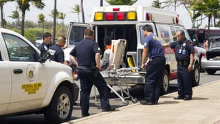 A 15-year-old boy is loaded into an ambulance in Maui, Hawaii, onApril 20, 2014, after surviving a five-hour flight from California to Hawaii hidden in the wheel well of a plane.YAHOO SCREENSHOT