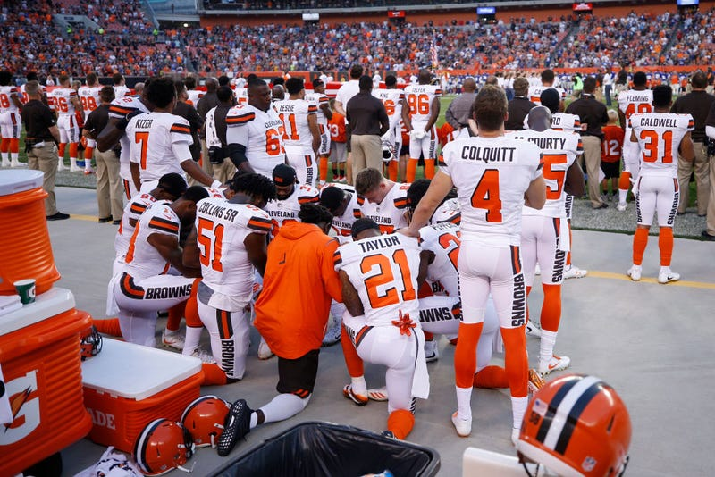 A group of Cleveland Browns players kneel in a circle in protest during the national anthem prior to a preseason game against the New York Giants at FirstEnergy Stadium in Cleveland on Aug. 21, 2017. (Joe Robbins/Getty Images)