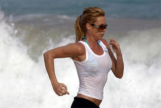 Illustration for article titled Nicolette Sheridan Makes Awesome Exercise-Face