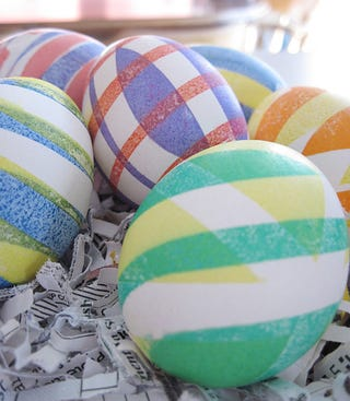 Illustration for article titled Dye Striped Easter Eggs with Electrical Tape