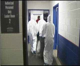 Illustration for article titled Crews In Hazmat Suits Cleaned The Locker Room After The Bucs Left