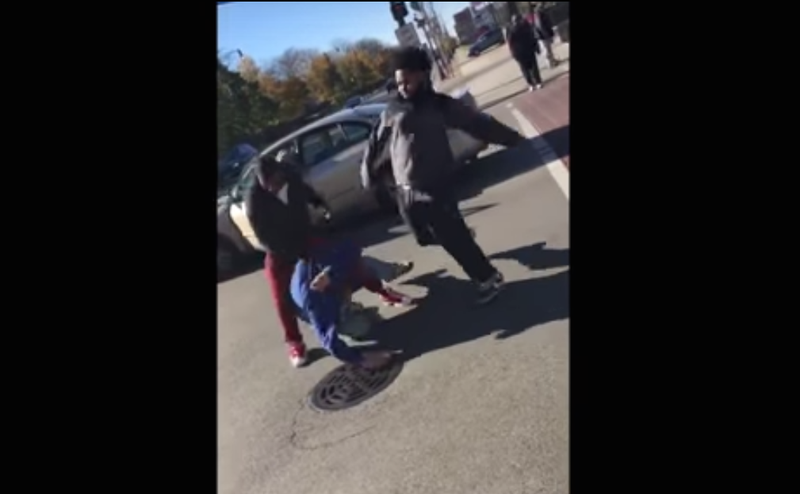 """A group of young men and women in Chicago were caught on camera attacking another man while bystanders shouted, """"Don't vote Trump!"""" YouTube screenshot"""