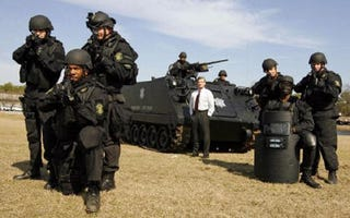Illustration for article titled Rambo P. Coltrane: South Carolina Sheriff Invests In APC Armed With .50-cal Machine Gun