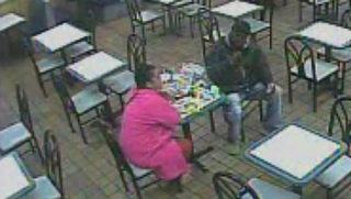 The suspect (right) dining with a companion in the McDonald's restaurant in Philadelphia Nov. 3, 2014 Screenshot from surveillance footage