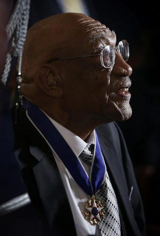 Golfer Charles Sifford looks on after President Barack Obama presented him with the Presidential Medal of Freedom during an East Room ceremony at the White House Nov. 24, 2014, in Washington, D.C. The Presidential Medal of Freedom is the nation's highest civilian honor.Alex Wong/Getty Images