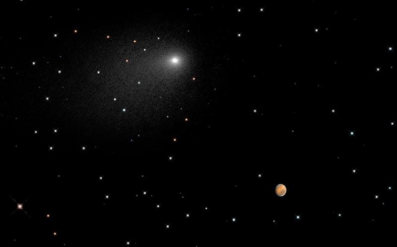 Illustration for article titled El Hubble capta una imagen única de Marte y el cometa Siding Spring