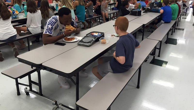 Travis Rudolph and middle schooler Bo Paske having lunchFacebook
