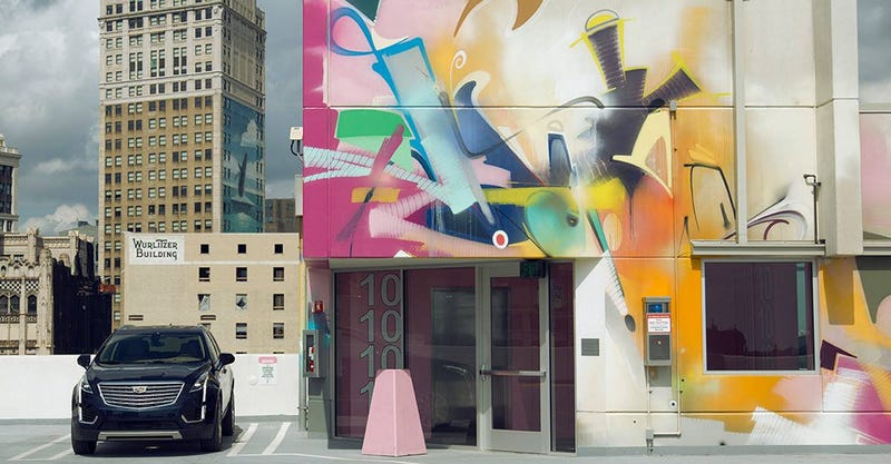 The Cadillac photo featuring Smash 137's mural in Detroit.