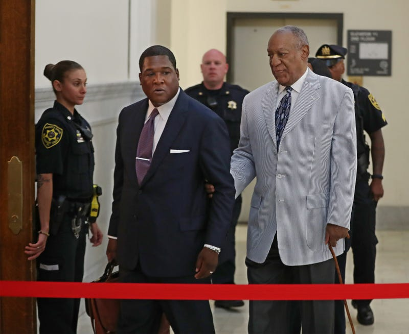 Bill Cosby (right) is led into the Montgomery County Courthouse by one of his aides Sept. 6, 2016, in Norristown, Pa.Michael Bryant-Pool/Getty Images