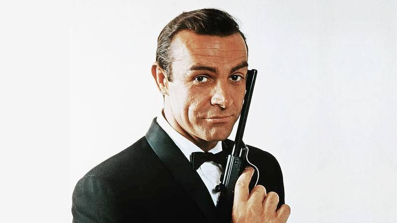 Sean Connery as James Bond holding a gun