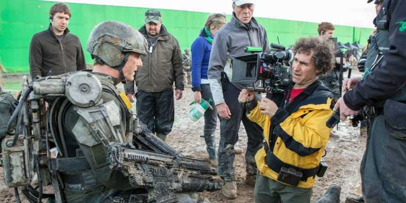 Doug Liman, right, directs Tom Cruise in Edge of Tomorrow. He may next helm the YA adaptation Chaos Walking. Image: Warner Bros.