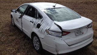 Illustration for article titled Unsuspecting Driver Gets Ford Slashed By Airplane Propeller