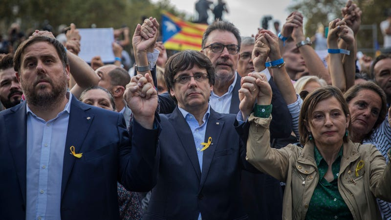 President Carles Puigdemont, center, with Vice President Oriol Junqueras, left. Via the AP.
