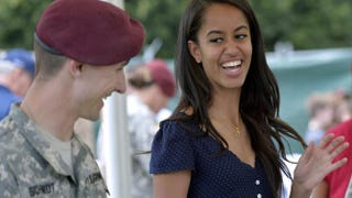 Malia Obama smiles as she serves food during a lunch at the United States and NATO military base in Vicenza, Italy, on June 19, 2015.ANDREAS SOLARO/AFP/Getty Images