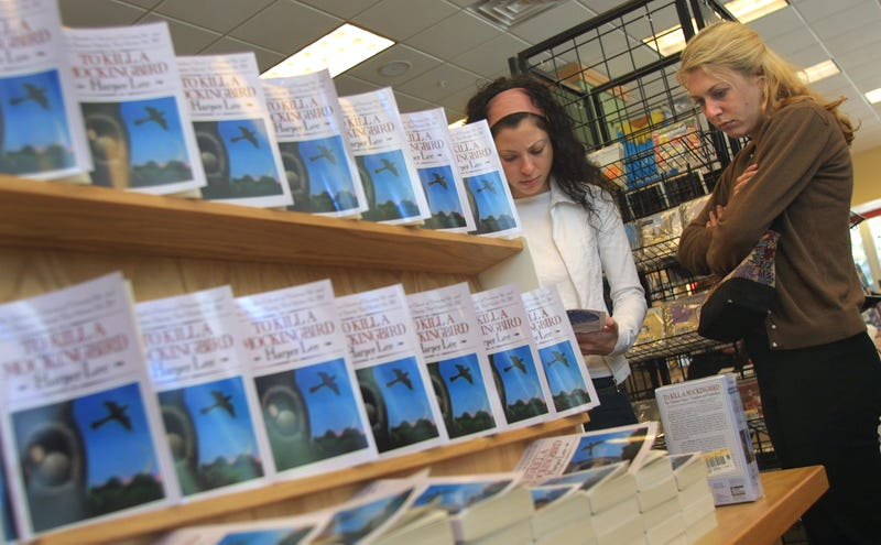Shoppers read about a Chicago program involving the 40th-anniversary edition of Harper Lee's Pulitzer Prize-winning novel, To Kill a Mockingbird, on Sept. 10, 2001, at a Borders Books and Music store in Chicago. (Tim Boyle/Getty Images)