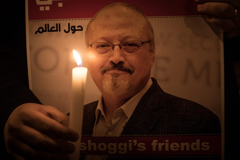 People take part in a candle light vigil to remember journalist Jamal Khashoggi outside the Saudi Arabia consulate on October 25, 2018 in Istanbul, Turkey.