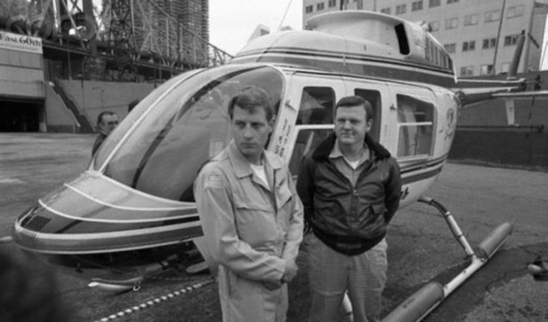 Perot, right, with pilot J.W. Coburn. (Bettman/Corbis)