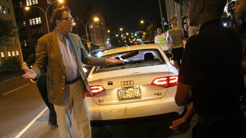 Illustration for article titled An Angry, Fashionable Downtown Mob Totally Bashed An Audi During 'Fashion Night Out'