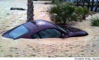 Illustration for article titled Hurricane Ida Buries Porsche Cayman In North Carolina Beach