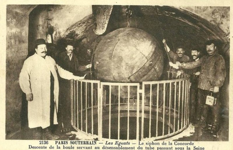 Illustration for article titled Paris unclogs its sewers with giant balls of iron