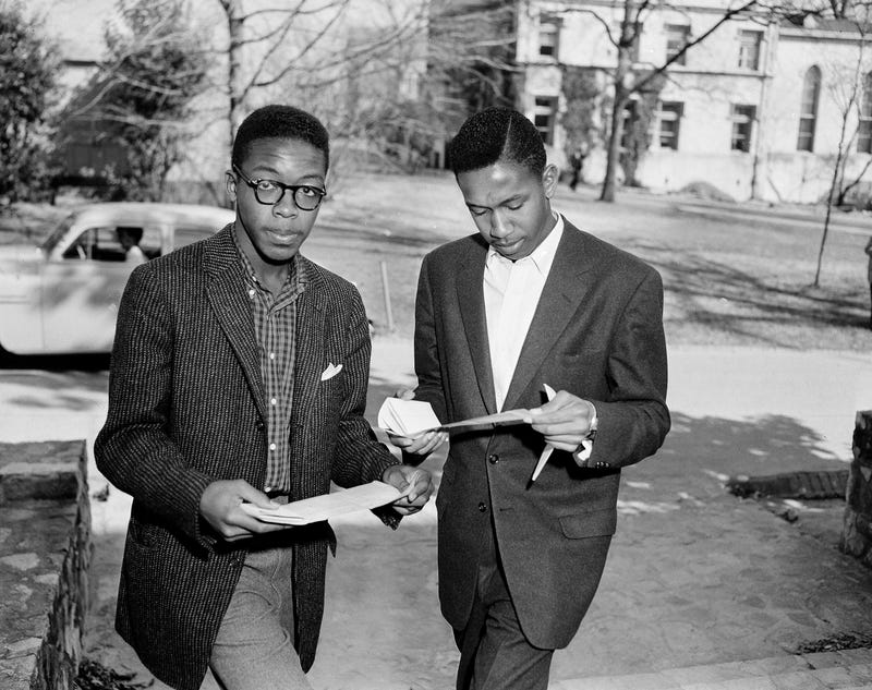 LeRoy and Ralph Frasier are shown on the University of North Carolina campus after registering for the second semester on Feb. 7, 1956. They were the first undergraduate African-American students to attend the  university. (Rudolph Faircloth/AP Images)